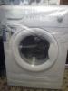 Новая стиральная машина в упаковке маленькая